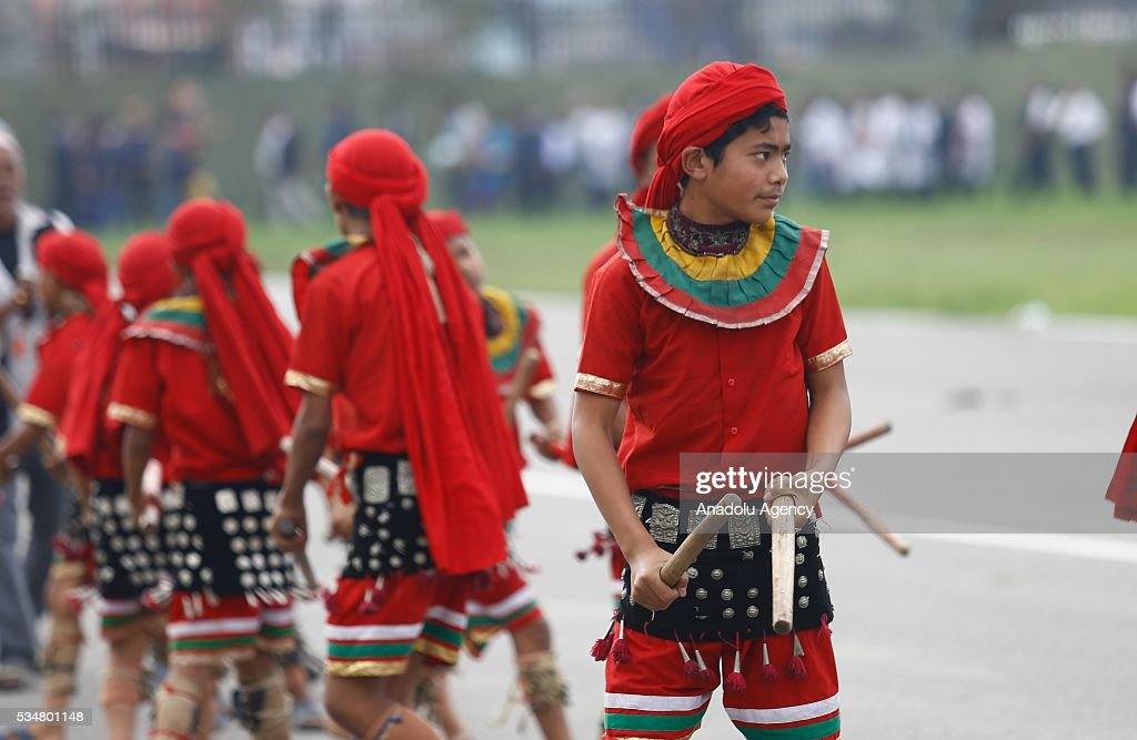 Nepalese people perform during the 9th Republic Day parade in Kathmandu, Nepal on May 28, 2016.