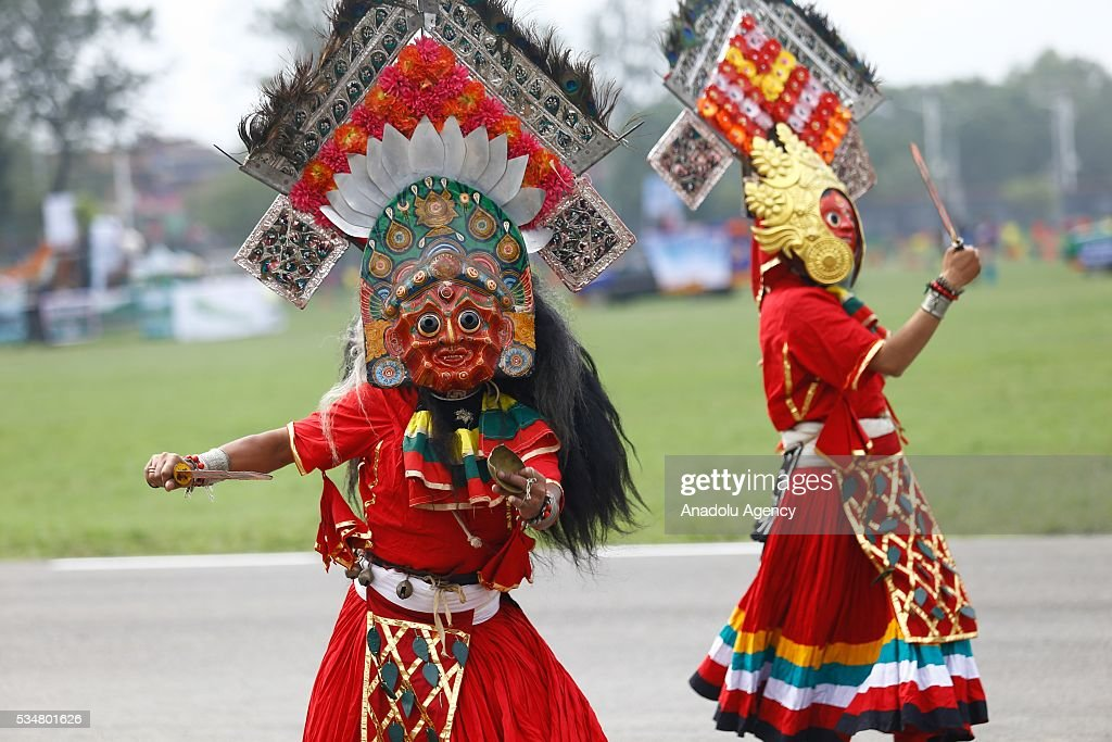 Nepalese people perform traditional mask dance during the 9th Republic Day parade in Kathmandu, Nepal on May 28, 2016.