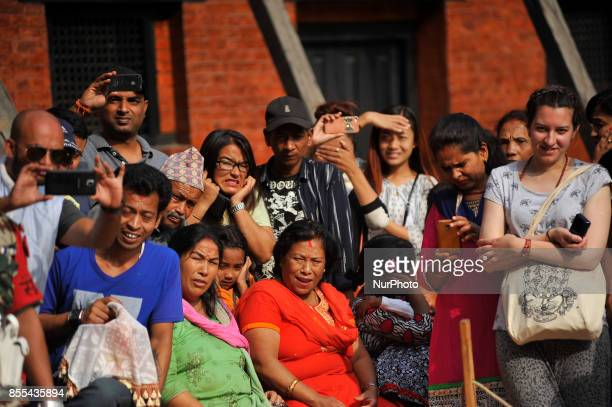Nepalese people reacts as after a devotees sacrifice a buffalo on the occasion of Navami 9th day of Dashain Festival at Basantapur Durbar Square...