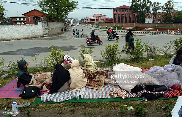Nepalese people rest in their makeshift shelter next to a road in Kathmandu on April 27 two days after a 78 magnitude earthquake hit Nepal...