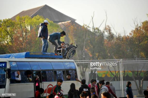 Nepalese people taking out wheelchair from roof of bus for the 1st Bodhisattvas In Action Wheelchair 4Km Marathon competition at Bhrikuti Mandap...