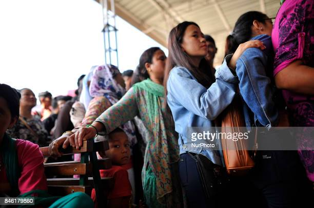 Nepalese People wait in queue to book tickets in advance for the upcoming Biggest Dashain Festival celebration at New Bus park Kathmandu Nepal on...