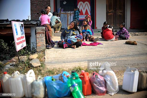 Nepalese people waiting for their turn to buy kerosene For the past few months neighboring India has blocked the transportation of fuel and daily...
