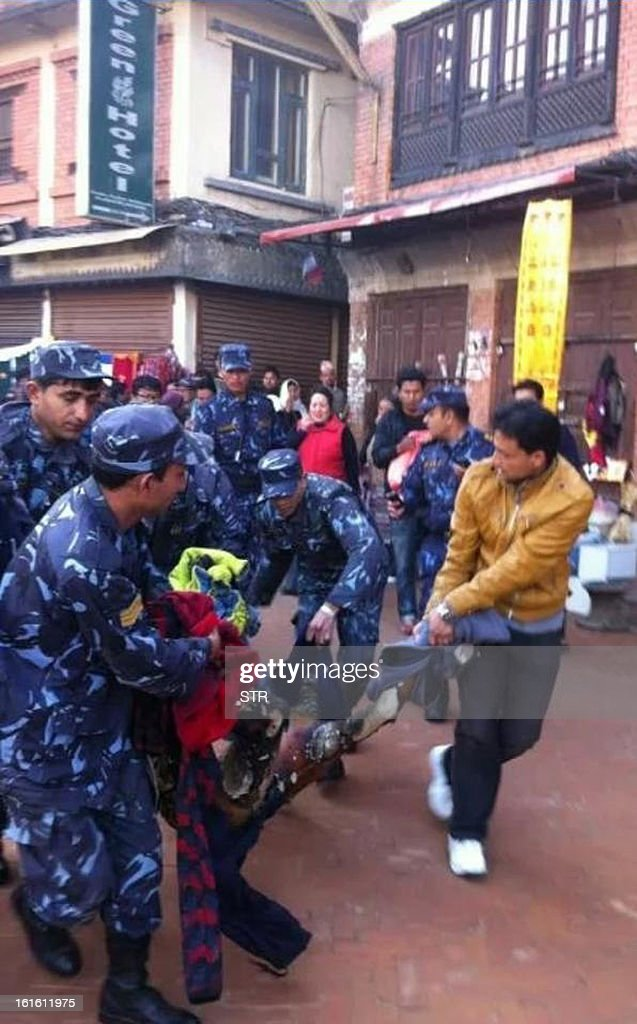 Nepalese police carry an exiled Tibetan monk, that set himself on fire at Boudhanath Stupa, to a hospital in Kathmandu on February 13, 2013. A Tibetan monk doused himself in petrol in a Kathmandu restaurant and set himself on fire, marking the 100th self-immolation bid in a wave of protests against Chinese rule since 2009. Police in the Nepalese capital told AFP that the exile had burned himself in an eatery near Kathmandu's Boudhanath Stupa, one of the world's holiest Buddhist shrines, terrifying tourists who were having breakfast.