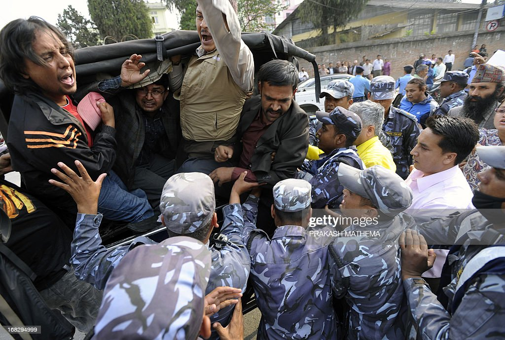 Nepalese police detain activists demonstrating against the Constitutional Council's appointment of Lokman Singh Karki as Commission for the Investigation of Abuse of Authority chief, in Kathmandu on May 8, 2013. Dozens of rights activists and student organisations have been protesting since the start of the week over the decision to appoint Lokman Singh Karki to run the Commission for the Investigation of Abuse of Authority. AFP PHOTO/ Prakash MATHEMA