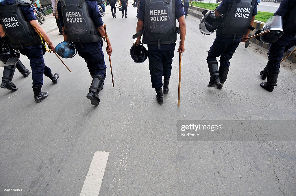 Nepalese police personnel guard during a protest rally to pressurize Government of Nepal for Black marketing, corruption, Price Hiking, Smuggling and remedy leave of Cadres & Political Leader of CPN Maoist at Singha Durbar, Kathmandu, Nepal on June 30, 2016.