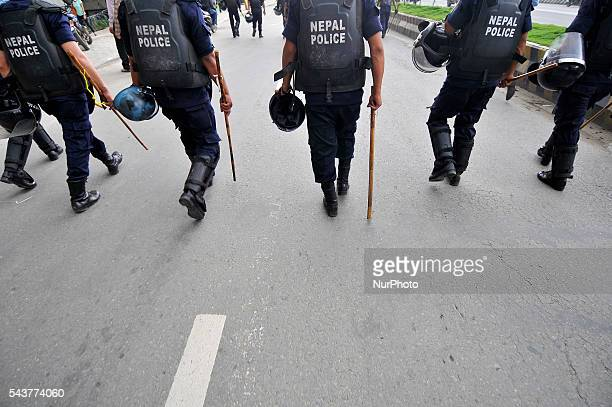 Nepalese police personnel guard during a protest rally to pressurize Government of Nepal for Black marketing corruption Price Hiking Smuggling and...
