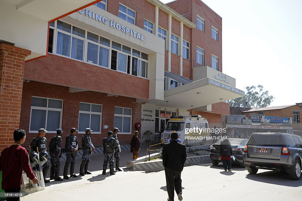Nepalese police stand guard outside a hospital where a Tibetan Buddhist monk is receiving treatment after he self-immolated in Kathmandu on February 13, 2013. A Tibetan monk doused himself in petrol in a Kathmandu restaurant on Wednesday and set himself on fire, marking the 100th self-immolation bid in a wave of protests against Chinese rule since 2009. AFP PHOTO/Prakash MATHEMA
