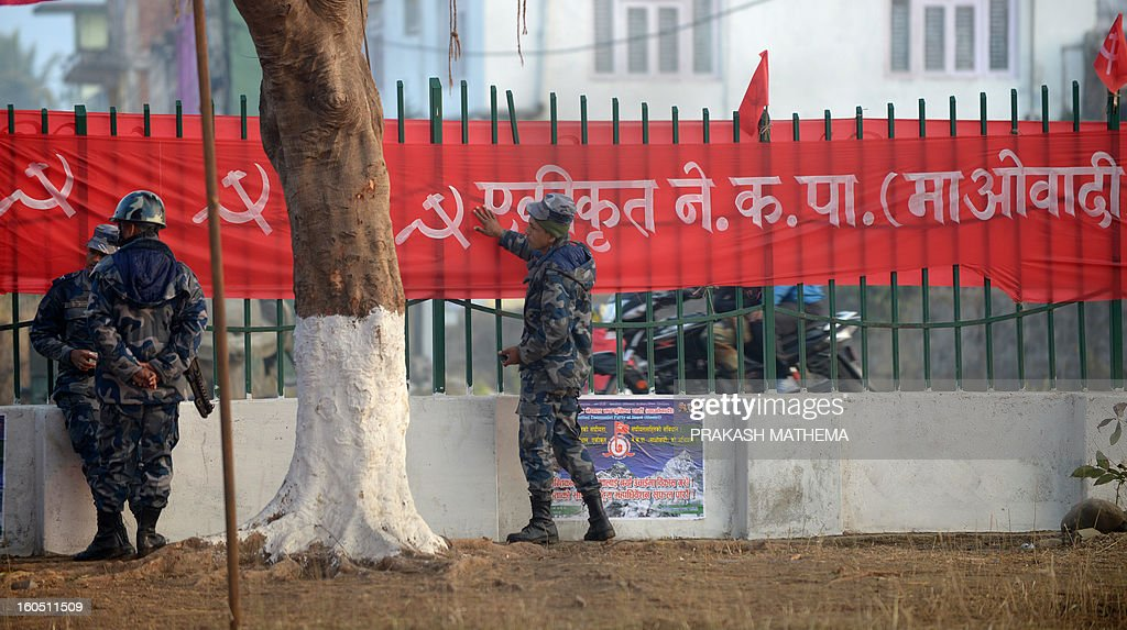 Nepalese police stand outside the venue of the Unified Communist Party of Nepal (Maoist) general convention at Hetauda, some 100 kms south of Kathmandu on Febuary 2, 2013. Thousands of Nepal's former rebel Maoists are due to gather Saturday for their biggest show of strength since taking up arms in a 10-year insurgency and toppling the world's last Hindu monarchy. AFP PHOTO/Prakash MATHEMA