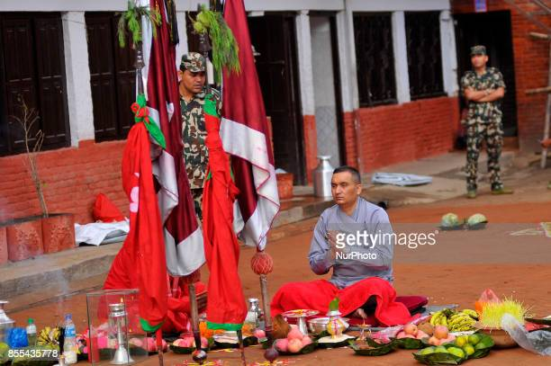 A Nepalese priest offering ritual puja before prepares to slaughter on the occasion of Navami ninth day of Dashain Festival at Basantapur Durbar...