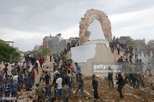 Nepalese rescue members gather at the collapsed Dharahara Tower in Kathmandu on April 25 2015 A powerful 79 magnitude earthquake struck Nepal causing...