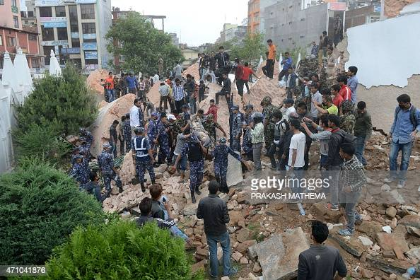 Nepalese rescue members move the body of a victim from the collapsed Dharahara Tower in Kathmandu on April 25 2015 A powerful 79 magnitude earthquake...