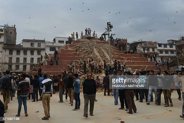 Nepalese rescue workers and onlookers gather at Kathmandu's Durbar Square a UNESCO World Heritage Site that was severely damaged by an earthquake on...