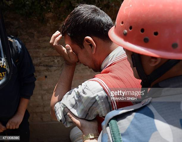 A Nepalese resident reacts as police retrieve the body of his relative Prasamsah during rescue efforts in Balaju in Kathmandu on April 27 2015...