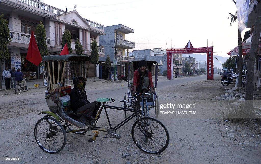 Nepalese rickshaw drivers wait for passengers attending the inauguration of the Unified Communist Party of Nepal (Maoist) general convention in Hetauda, some 100 km south of Kathmandu on February 2, 2013. Thousands of Nepal's former rebel Maoists are due to gather for their biggest show of strength since taking up arms in a 10-year insurgency and toppling the world's last Hindu monarchy. AFP PHOTO/Prakash MATHEMA