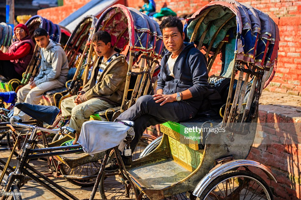 Nepalese rickshaws waiting for tourists on Durbar Square in Kathmandu : Stock Photo