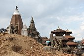 Nepalese security forces clear rubble out of a collapsed ancient building of the UNESCO world heritage site Patan Durbar Square after the earthquake...