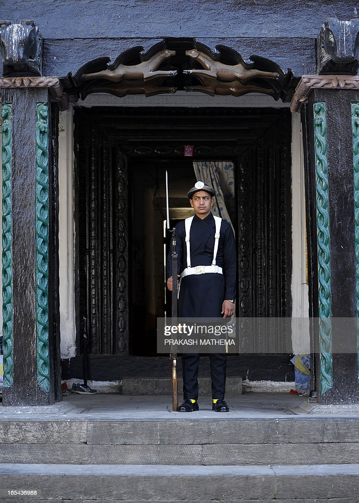A Nepalese soldier stands guard at Durbar museum in Kathmandu on April 4, 2013. The Durbar Square holds the palaces of the Malla and Shah kings who ruled over the city and isa UNESCO world heritage site located in the centre of the capital. AFP PHOTO/ Prakash MATHEMA