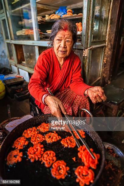 Nepalese street vendor preparing a sweet - jeri (jalebi), Bhaktapur