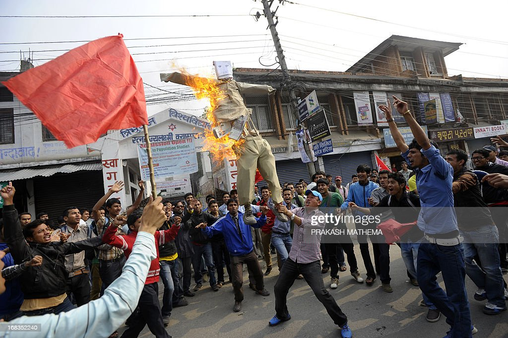 Nepalese student activists burn an effigy of Lokman Singh Karki after his appointment as Commission for the Investigation of Abuse of Authority chief in Kathmandu on May 9, 2013. Dozens of rights activists and student organisations have been protesting since the start of the week over the Constitutional Council's decision to appoint Lokman Singh Karki to run the Commission for the Investigation of Abuse of Authority. AFP PHOTO/ Prakash MATHEMA