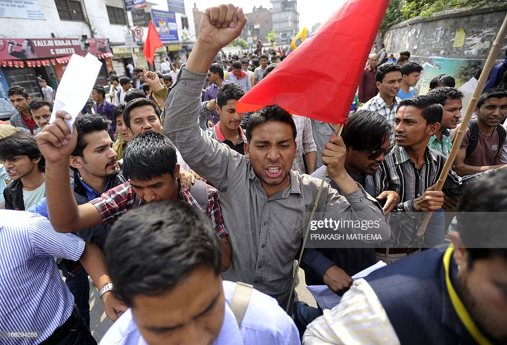 Nepalese student activists demonstrate against the Constitutional Council's appointment of Lokman Singh Karki as Commission for the Investigation of Abuse of Authority chief, in Kathmandu on May 8, 2013. Dozens of rights activists and student organisations have been protesting since the start of the week over the decision to appoint Lokman Singh Karki to run the Commission for the Investigation of Abuse of Authority. AFP PHOTO/ Prakash MATHEMA