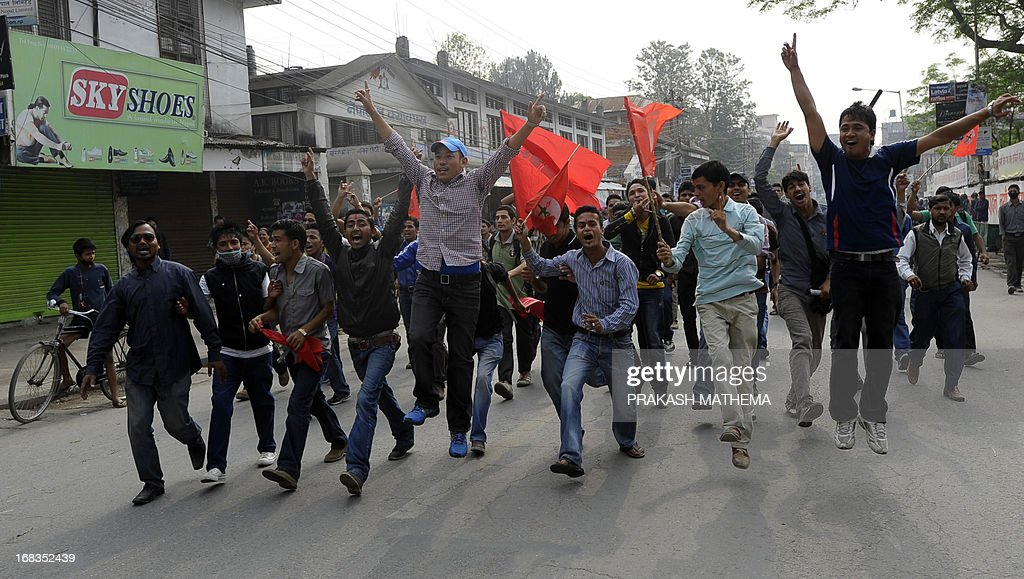 Nepalese student activists demonstrate against the Constitutional Council's appointment of Lokman Singh Karki as Commission for the Investigation of Abuse of Authority chief, in Kathmandu on May 9, 2013. Dozens of rights activists and student organisations have been protesting since the start of the week over the decision to appoint Lokman Singh Karki to run the Commission for the Investigation of Abuse of Authority. AFP PHOTO/ Prakash MATHEMA