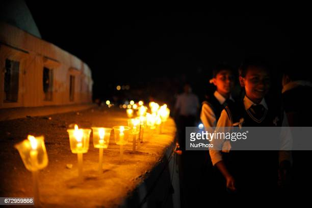 Nepalese Students from Boudhanath Higher Seconday School pays homage towards Earthquake victims on Second Anniversary by lighting up candles at...