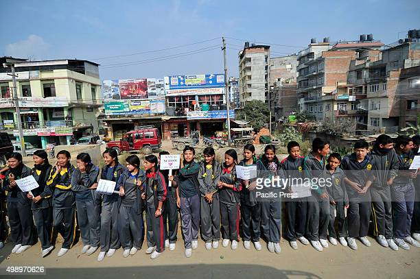 Nepalese students holds placards with different slogans as they take part in a protest rally to show solidarity against the border blockade at...