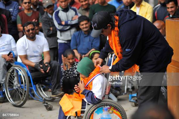 Nepalese Super Hero RAJESH HAMAL honouring Nepalese youngest wheelchair racer after competing in the 1st Bodhisattvas In Action Wheelchair 4Km...