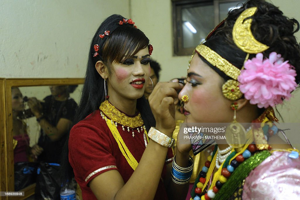 Nepalese transgendered performers put on make up backstage for an event on the International Day Against Homophobia and Trans-phobia in Kathmandu on May 17, 2013. Nepal, home to Asia's leading gay and transgender rights movement, legally recognizes a third gender category on documents for transgender people. AFP PHOTO/Prakash MATHEMA