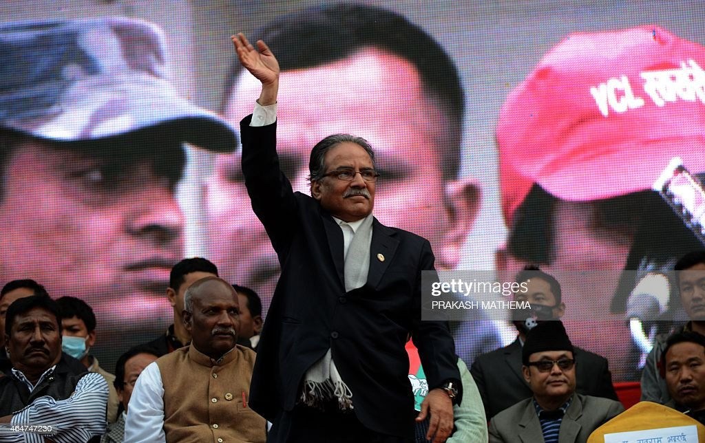 Nepalese Unified Communist Party of Nepal (Maoist) chairman <a gi-track='captionPersonalityLinkClicked' href=/galleries/search?phrase=Pushpa+Kamal+Dahal&family=editorial&specificpeople=565314 ng-click='$event.stopPropagation()'>Pushpa Kamal Dahal</a>, known better as Prachanda, (C), waves to supporters of the 30-party alliance led by the Unified Communist Party of Nepal (Maoist) during mass-demonstrations in Kathmandu on February 28, 2015. Nepalese police February 28 fired teargas and water cannon at thousands of opposition supporters who converged on the capital to protest controversial plans to vote on a disputed new national constitution.
