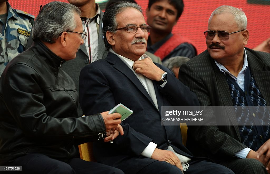 Nepalese Unified Communist Party of Nepal (Maoist) chairman <a gi-track='captionPersonalityLinkClicked' href=/galleries/search?phrase=Pushpa+Kamal+Dahal&family=editorial&specificpeople=565314 ng-click='$event.stopPropagation()'>Pushpa Kamal Dahal</a>, known better as Prachanda, (C), sits alongside other leaders during mass-demonstrations by the 30-party alliance led by the Unified Communist Party of Nepal (Maoist) in Kathmandu on February 28, 2015. Nepalese police February 28 fired teargas and water cannon at thousands of opposition supporters who converged on the capital to protest controversial plans to vote on a disputed new national constitution. AFP PHOTO / PRAKASH MATHEMA