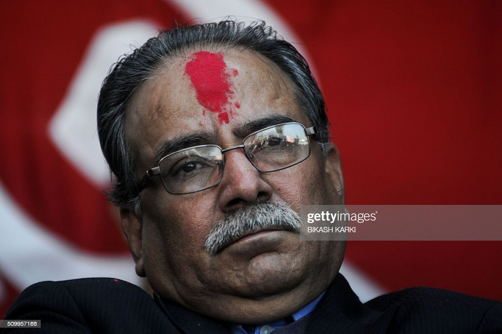Nepalese Unified Maosit Chairman Puspa Kamal Dahal (also known as Prachanda) looks on during an event to mark the 21st Peoples War Day in Kathmandu on February 13, 2016. Nepal's former Maoist rebels paid tribute to fallen comrades February 13 in a ceremony marking 20 years since the start of an insurgency that transformed the Himalayan nation from a Hindu monarchy to a secular republic. AFP PHOTO / Bikash Karki / AFP / BIKASH KARKI