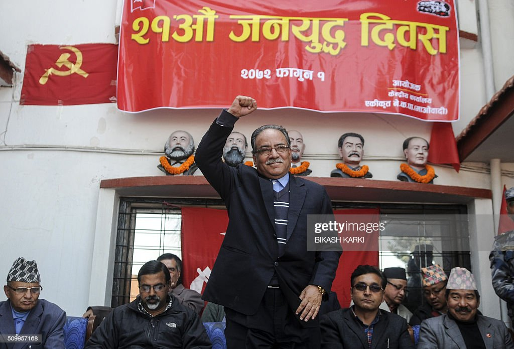 Nepalese Unified Maosit Chairman Puspa Kamal Dahal (C, also known as Prachanda) greets party members during an event to mark the 21st Peoples War Day in Kathmandu on February 13, 2016. Nepal's former Maoist rebels paid tribute to fallen comrades February 13 in a ceremony marking 20 years since the start of an insurgency that transformed the Himalayan nation from a Hindu monarchy to a secular republic. AFP PHOTO / Bikash Karki / AFP / BIKASH KARKI