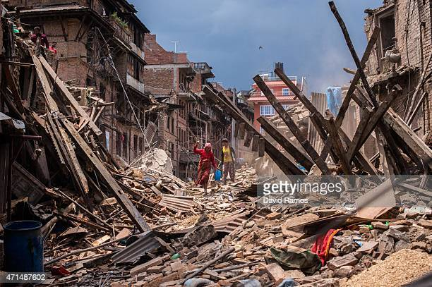 Nepalese victims of the earthquake search for their belongings among debris of their homes on April 29 2015 in Bhaktapur Nepal A major 78 earthquake...