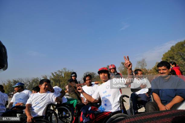 Nepalese wheelchair racer celebrates after competing in the 1st Bodhisattvas In Action Wheelchair 4Km Marathon competition at Bhrikuti Mandap...