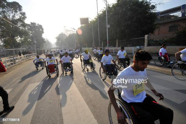 Nepalese wheelchair racer competing in the 1st Bodhisattvas In Action Wheelchair 4Km Marathon competition at Bhrikuti Mandap Kathmandu Nepal on...