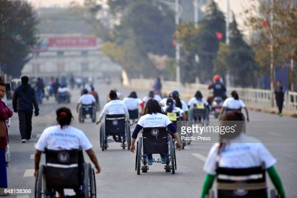 Nepalese wheelchair racer competing in the 1st Bodhisattvas In Action wheelchair 4km marathon competition at Bhrikuti Mandap There were 150...