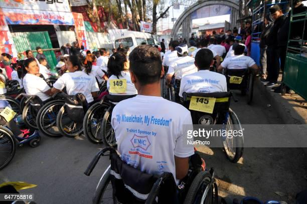Nepalese wheelchair racer participate in the 1st Bodhisattvas In Action Wheelchair 4Km Marathon competition at Bhrikuti Mandap Kathmandu Nepal on...