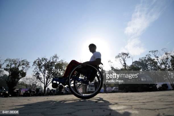 Nepalese wheelchair racer takes rest after competing in the 1st Bodhisattvas In Action Wheelchair 4Km Marathon competition at Bhrikuti Mandap...