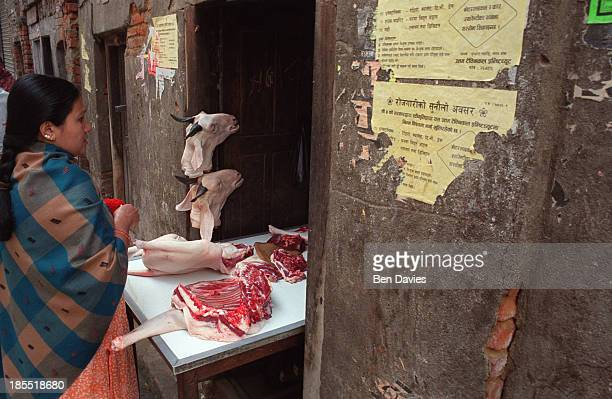 Nepalese woman buys goat meat from a butcher a short distance from Durbar Square in the old part of Katmandu in Nepal Despite growing numbers of more...