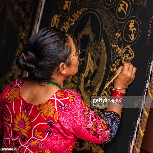 Nepalese woman painting a thanka in Bhaktapur