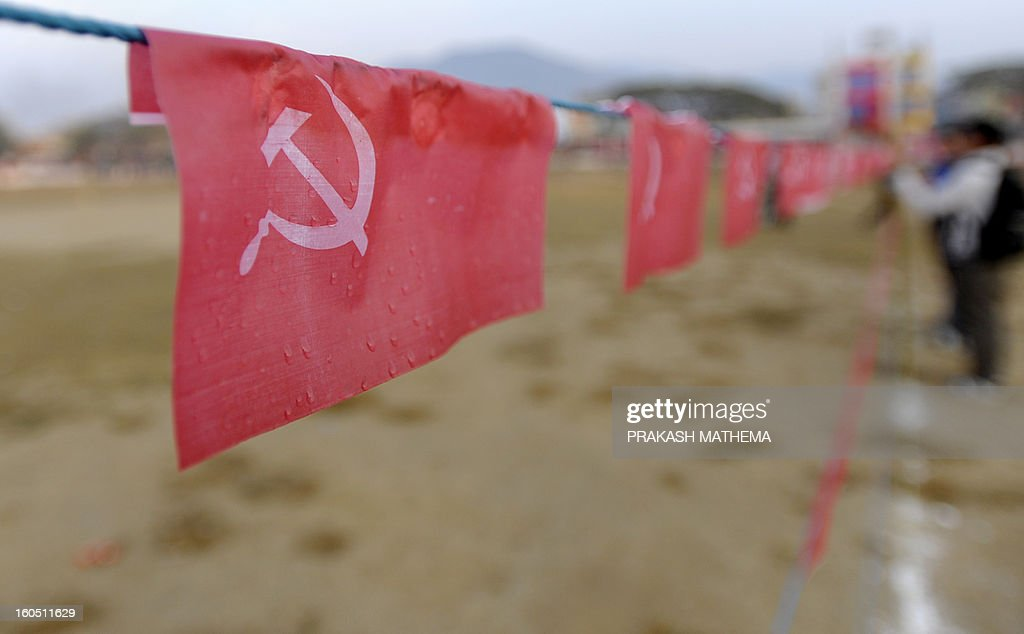 Nepalese workers prepare for the Unified Communist Party of Nepal (Maoist) general convention at Hetauda, some 100 kms south of Kathmandu on Febuary 2, 2013. Thousands of Nepal's former rebel Maoists are due to gather Saturday for their biggest show of strength since taking up arms in a 10-year insurgency and toppling the world's last Hindu monarchy. AFP PHOTO/Prakash MATHEMA