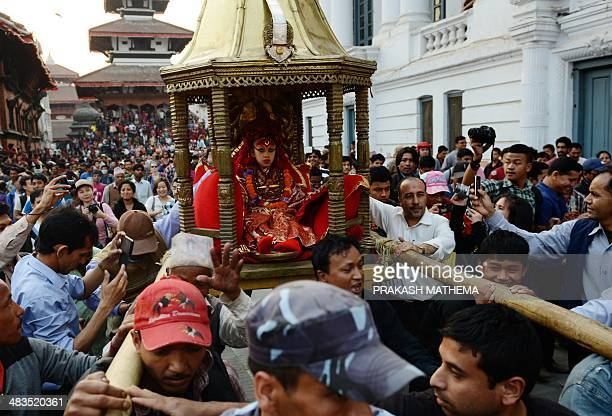 Nepalese worshippers carry the Living Goddess 'Kumari Devi' during a procession on the last day of the Seto Machindranath chariot festival in...
