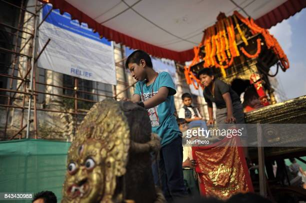 Nepalese young kids playing on the chariot of Kumari on the fourth day of Indra Jatra Festival celebrated at Basantapur Durbar Square Kathmandu Nepal...