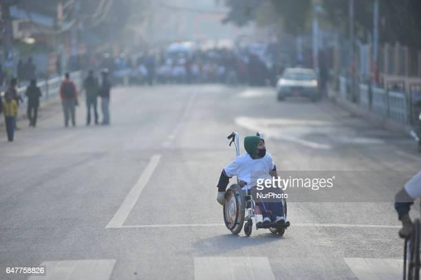 Nepalese youngest wheelchair racer competing in the 1st Bodhisattvas In Action Wheelchair 4Km Marathon competition at Bhrikuti Mandap Kathmandu Nepal...