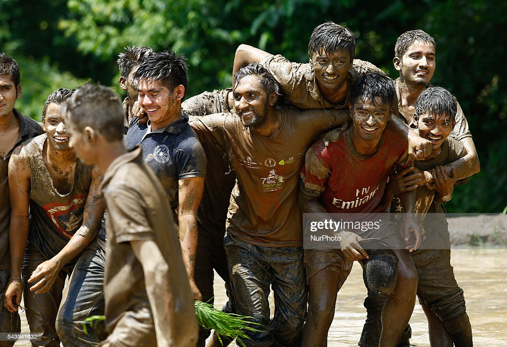 Nepalese youth cover in mud plays in the paddy field during the National Paddy Day in the village at Lalitpur on the outskirts of Kathmandu, Nepal on June 29, 2016. Nepalese farmer celebrates National Paddy Day on Asar 15 of Nepal Calendar as the annual rice planting season begins.