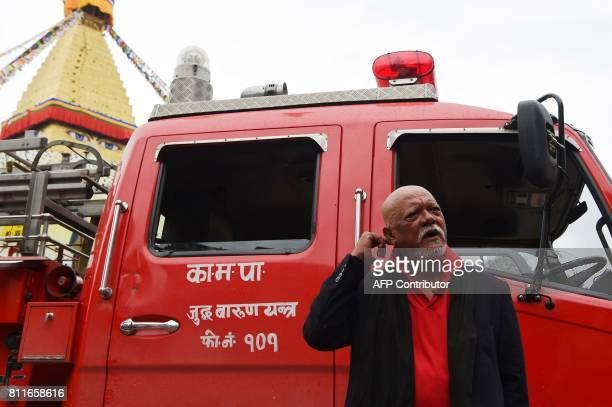 Nepali Bollywood star Sunil Thapa posed for a picture during an interview with AFP next to a fire truck at the Boudhanath Stupa in Kathmandu on July...