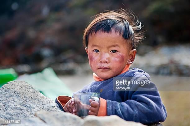 Nepali boy drinking milk tea.