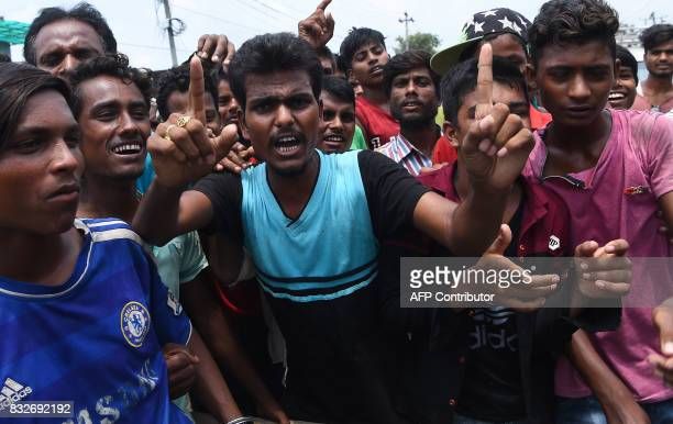 Nepali flood victims chant slogans as they demand relief material from the local government in Biratnagar some 240 kms from Nepal's capital Kathmandu...
